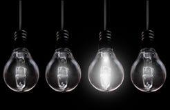 Light bulb amongst unlit Royalty Free Stock Images