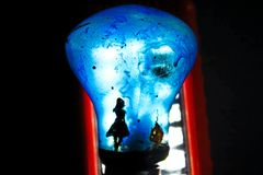 Light bulb with artistic spooky painting royalty free stock photos