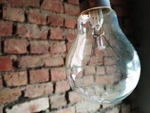 Light Bulb. The light bulb attached to the wall is visible Royalty Free Stock Photo