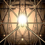The light bulb on the background of the Electricity pylons. Technological background Royalty Free Stock Photo