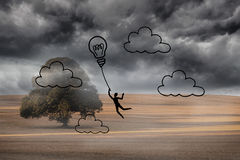 Light bulb balloon over cloudy landscape Royalty Free Stock Image