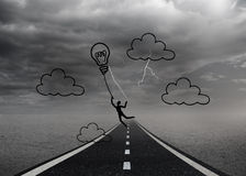 Light bulb balloon over street and stormy sky Stock Photography