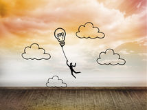 Light bulb balloon on wall with bright sky Royalty Free Stock Images