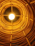 Light bulb in bamboo shade Royalty Free Stock Photo