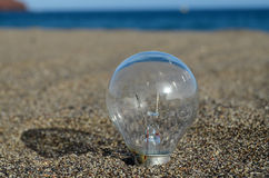 Light bulb on the beach Stock Images