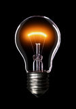 Light bulb on black background. Royalty Free Stock Photography