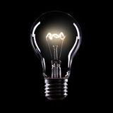 Light bulb. On black background Stock Photography