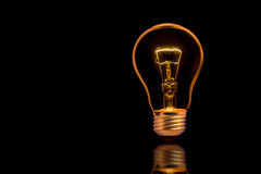 Light bulb. On black background Stock Photo