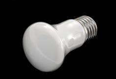 Light bulb on black background Stock Image