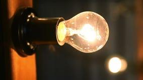 Light bulb on black background stock footage