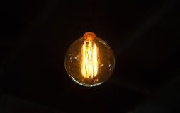 Light Bulb with black background Stock Photography