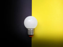 Light Bulb on Black and Yellow Paper Royalty Free Stock Image