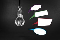 Light bulb on blackboard Royalty Free Stock Image