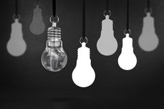 Light bulb on blackboard Stock Images