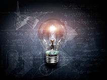 Light bulb on blackboard  concept - background. Light bulb on blackboard idea concept - background Stock Photos