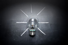 Light bulb on blackboard idea concept - background.  Royalty Free Stock Image