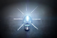 Light bulb on blackboard idea concept - background.  Royalty Free Stock Images