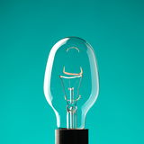 Light bulb on blue Royalty Free Stock Photography