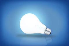 Light bulb on blue background Stock Photography