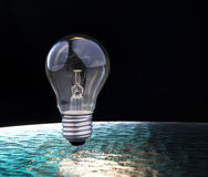 Light bulb on blue and black background Stock Photo