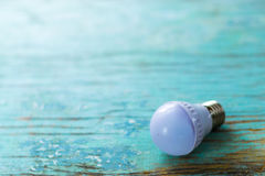 Light bulb on blue boards Royalty Free Stock Photo