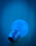 Light bulb and blue light Stock Photography