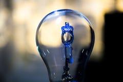 Light bulb. Blue light reflection on and ordinary light bulb Stock Photography