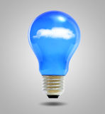 Light bulb and blue sky with clouds Stock Photography