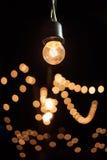 Light bulb. A light bulb and bokeh in the dark Stock Photo