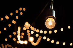 Light bulb. A light bulb and bokeh in the dark Royalty Free Stock Image