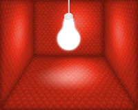 Light bulb in box. Light bulb hanging in a red green box Stock Images