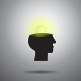 Light bulb in brain and head on gray background Stock Images