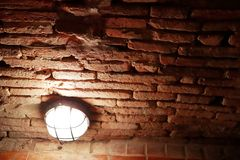 Light bulb in brick tunnel  at Wat Umong Changmai Thailand stock photos