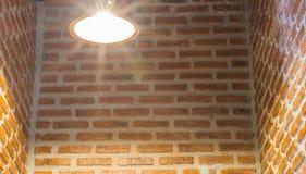 Light bulb on brick wall Royalty Free Stock Photography