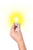 Light bulb with bright rays. Stock Image