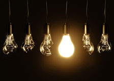 Light bulb and broken bulbs Royalty Free Stock Images