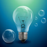 Light bulb and bubbles Royalty Free Stock Photos