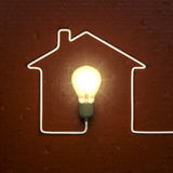 A light bulb building a house with the cable Royalty Free Stock Images