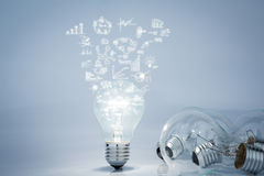 Light bulb with business concept and graph Stock Photos