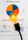 Light bulb with business graph placed Stock Photo