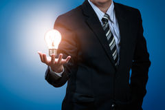 Light bulb. In businessman's hand Royalty Free Stock Photos