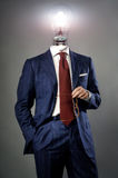 Light bulb on businessman - solution concept. Light bulb on red tie businessman - solution concept Stock Photos