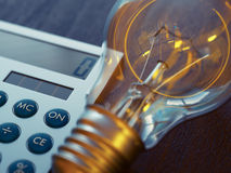 Light bulb and calculator Stock Photo