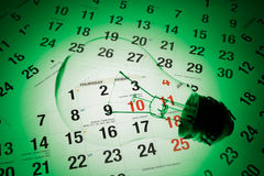 Light Bulb and Calendar Stock Photo