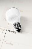 Light bulb on calendar, everyday innovation Stock Photography