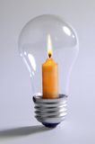 Light Bulb and Candle royalty free stock photos