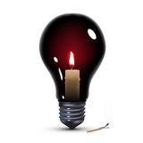 Light bulb with candle Royalty Free Stock Photo