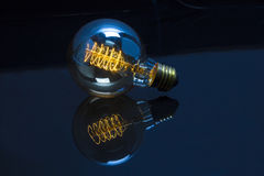 Light bulb capture energy Stock Image
