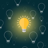 Light bulb in a cartoon style flat on a dark background Stock Image