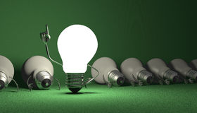 Light bulb character, aha moment  on green Stock Images
